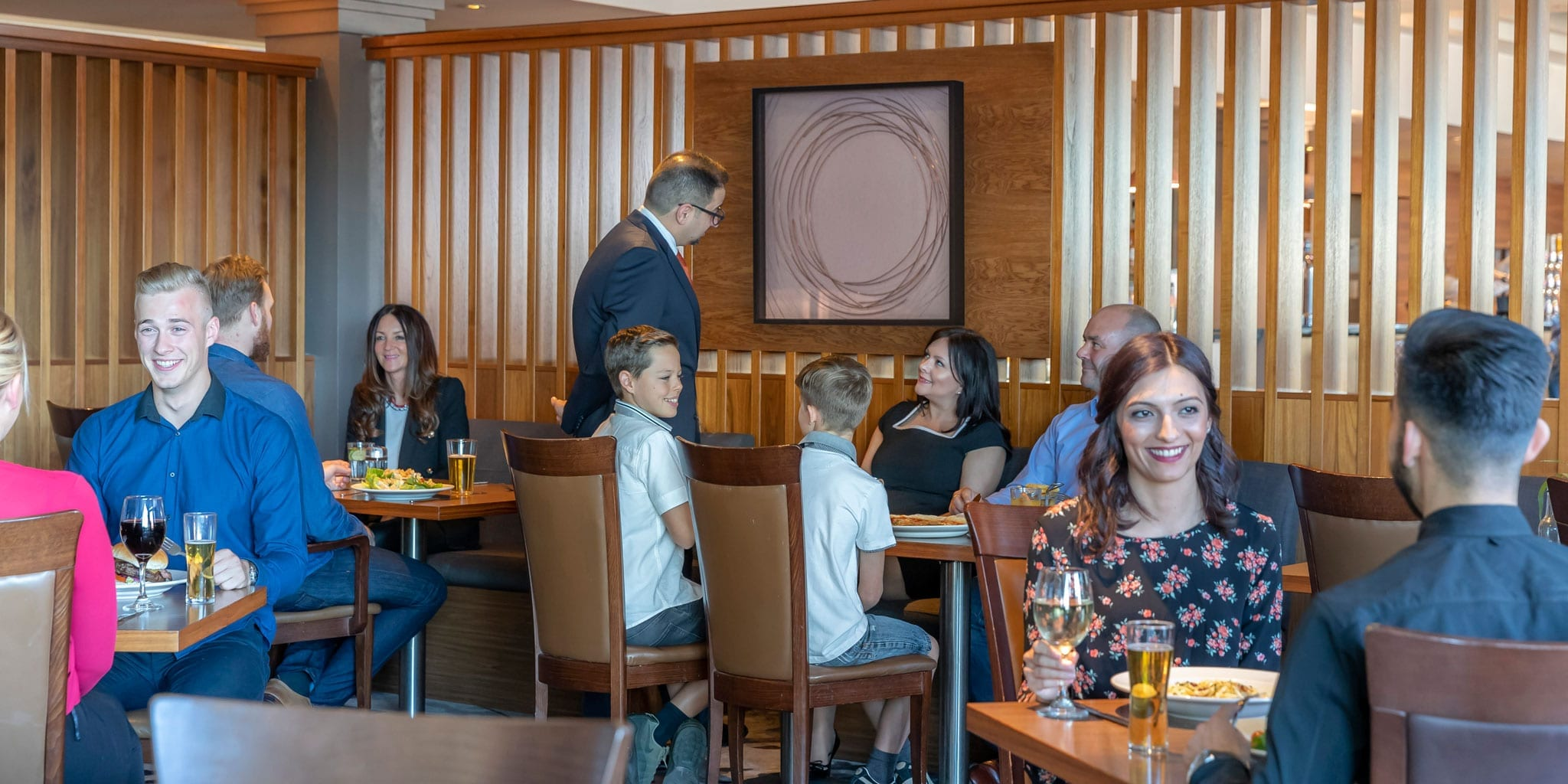 Happy family at the Grill Restaurant Clayton Hotel Manchester Airport