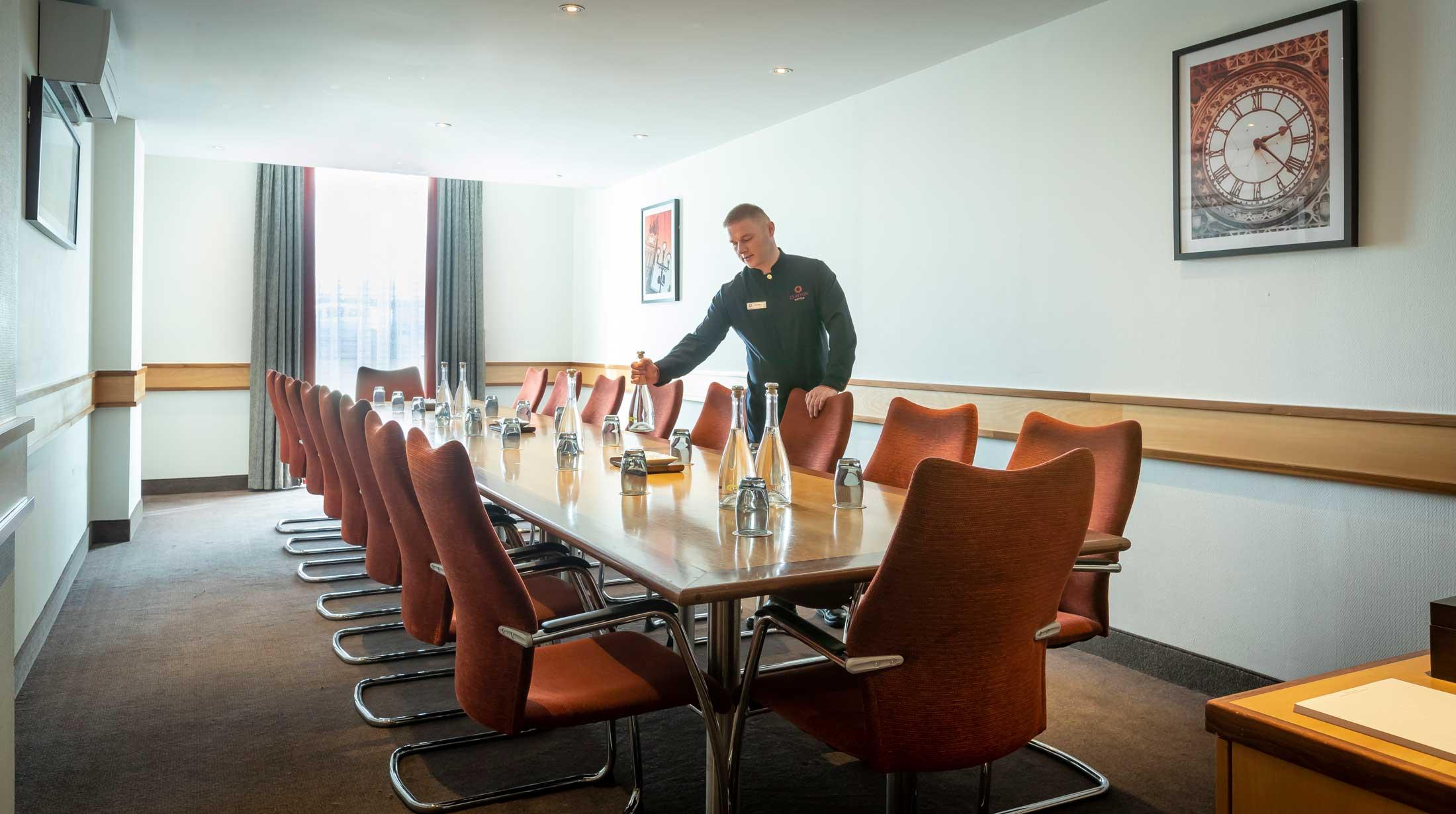 Staff preparing a boardoom meeting at Clayton Hotel Manchester Airport