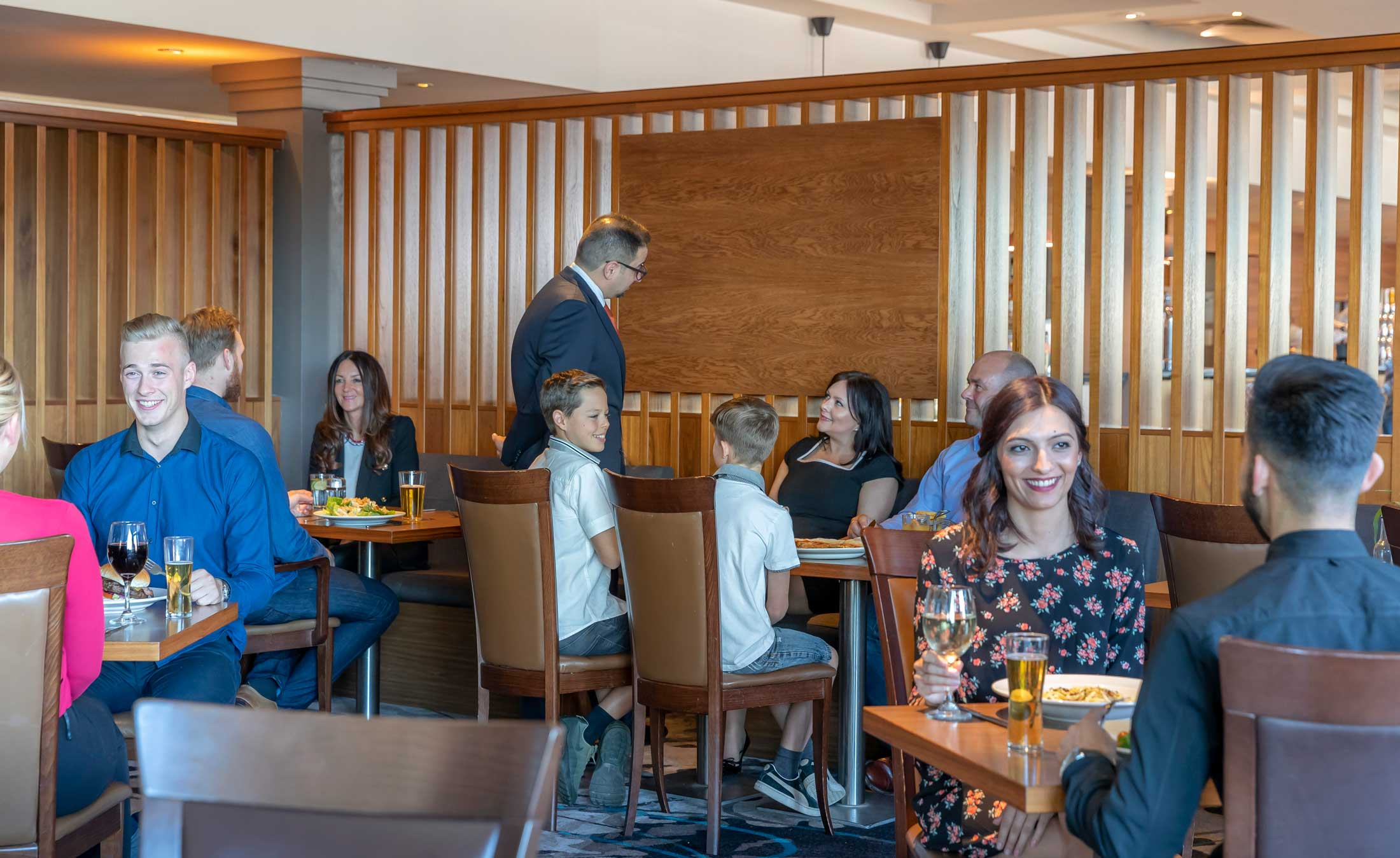 Guests dining in Clayton Hotel Manchester Airport restaurant