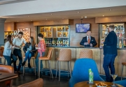 Guests relaxing in Aviator Bar
