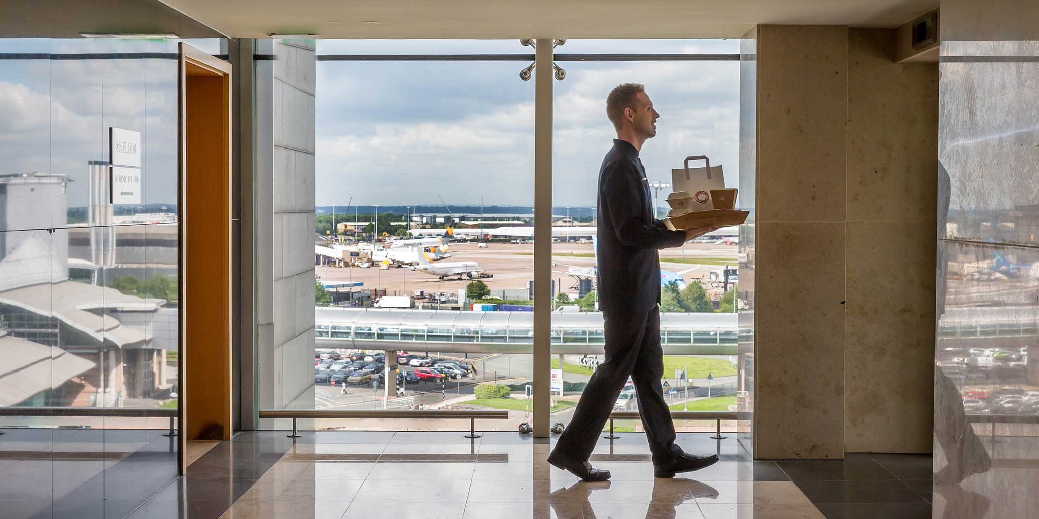waiter-delivering-room-service-Clayton-Hotel-Manchester-Airport