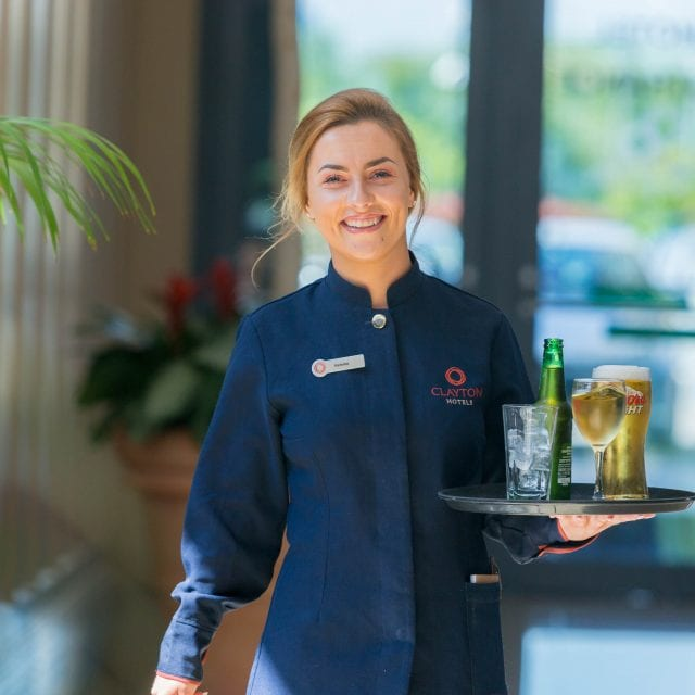 Waitress serving drinks in Clayton Hotel Manchester Airport